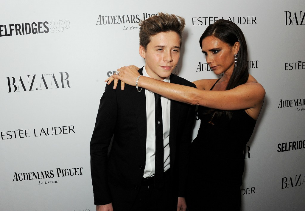 Victoria-Beckham-affectionately-wrapped-her-arms-around-her-son
